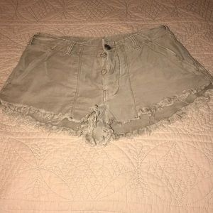 Free people beige distressed shorts